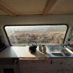 kitchen in a camper van with tea pot