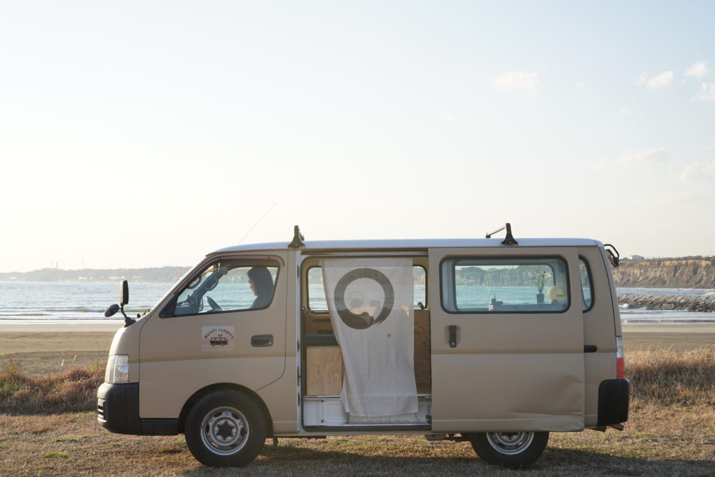 camper van with an open door and a Japanese curtain